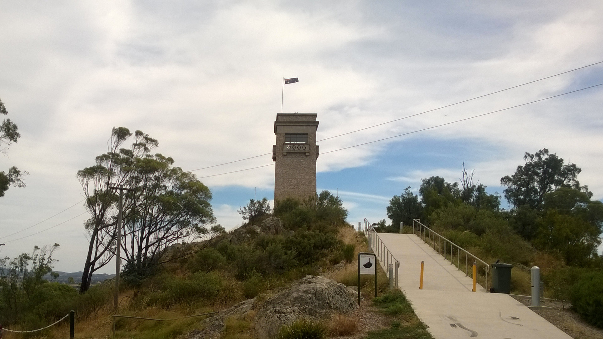 Looking at the stone tower from the parking area, built as a tribute to those of Goulburn who served in World War I. At the War Memorial Scenic Lookout on top of Rocky Hill in Goulburn