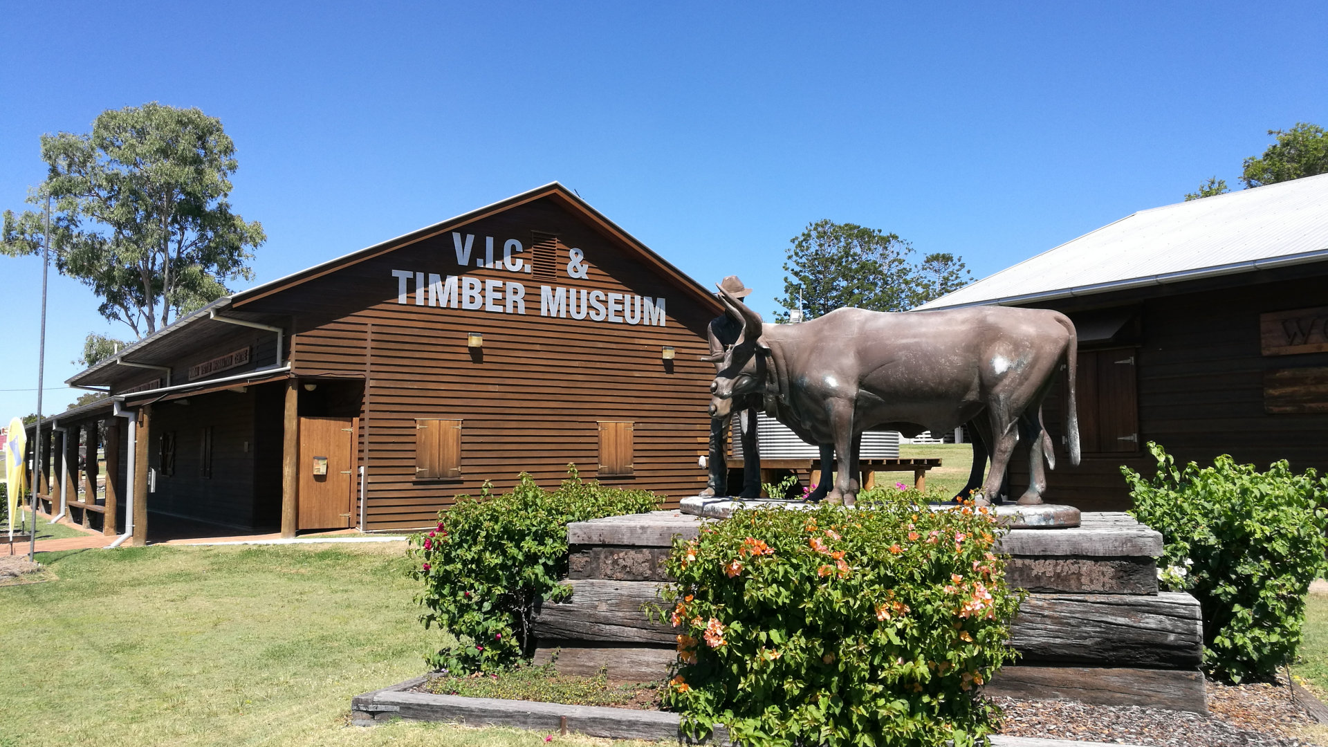 The Timber Museum in Wondai, part of the Wondai Visitor Information Centre, with a bullock statue. Inside is a timber display depicting early life in the timber industry