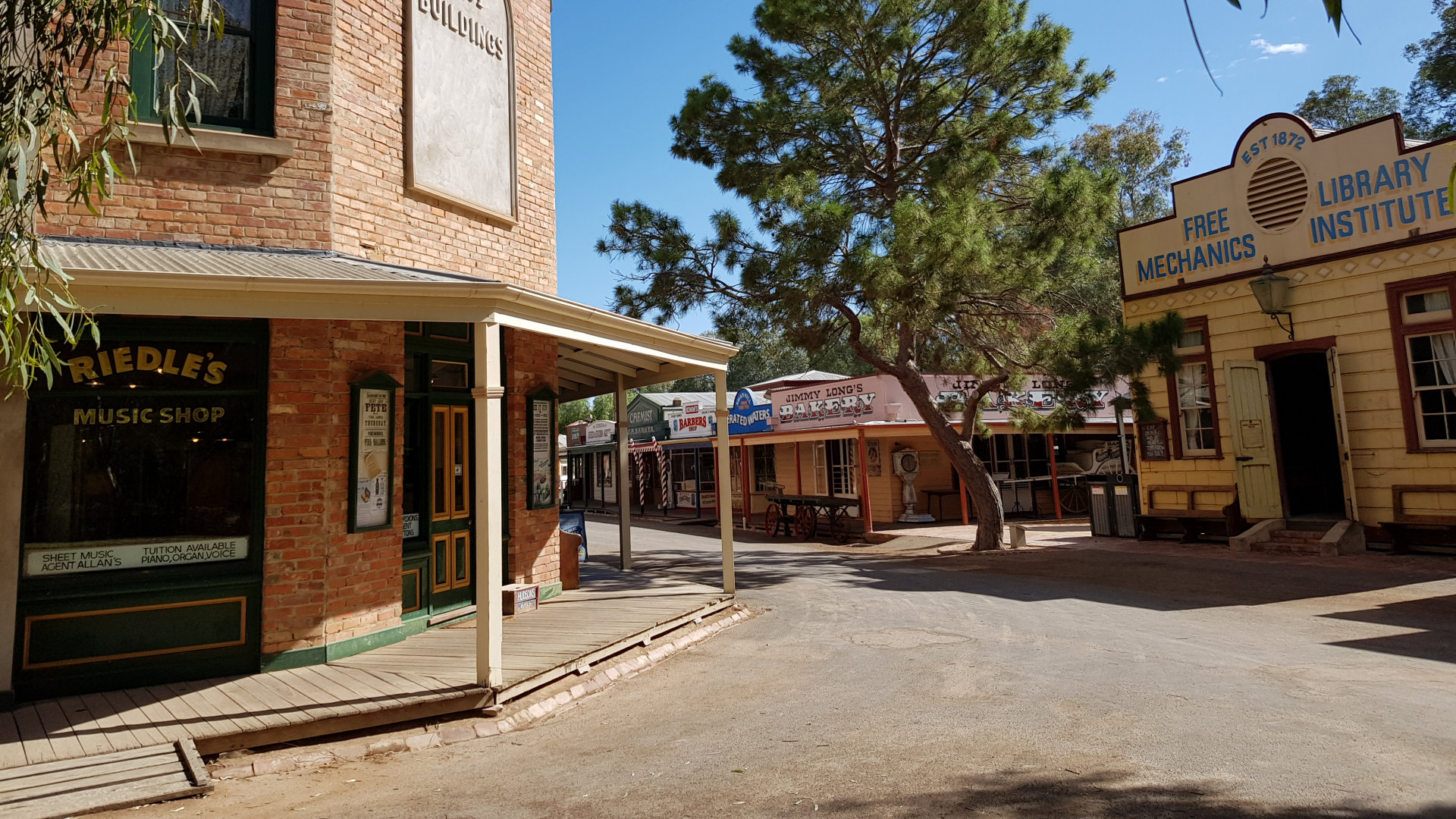 Street in The Pioneer Settlement with pioneering era buildings, a museum in Swan Hill set on the edge of the Little Murray River, with old farming equipment, paddle steamer cruise, and a laser, light and water show.