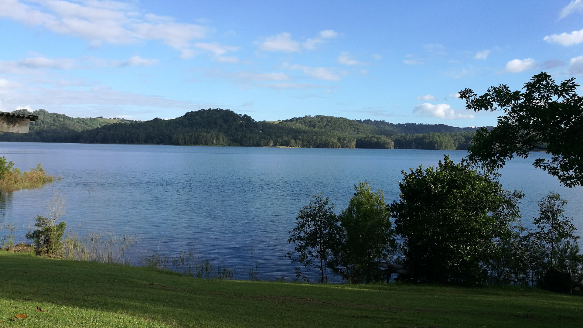 View of Lake Baroon from the northern recreational area near Montville. The lake is between Maleny and Montville on the Blackall Range. The lake is created from the Baroon Pocket Dam on the Obi Obi Creek, as a water supply for the Sunshine Coast area. The recreational area has picnic tables, BBQs and a playground.