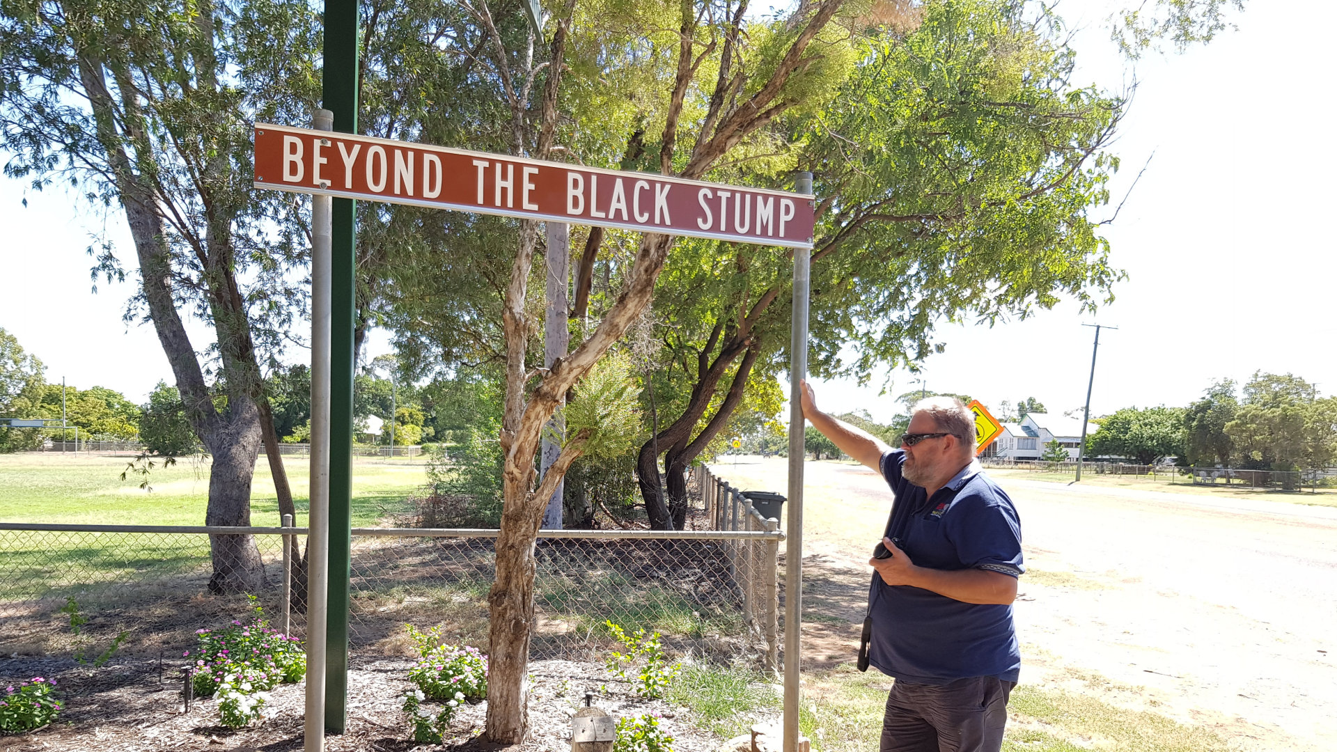 "Brown sign for ""Beyond the black stump"" at Blackall. Beyond the black stump considered to be a marker of the limits of established settlement in pioneering days in Australia. Blackall has the brown sign to show where it begins."