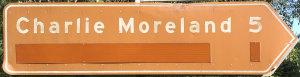 Brown sign for Charlie Moreland, 5km