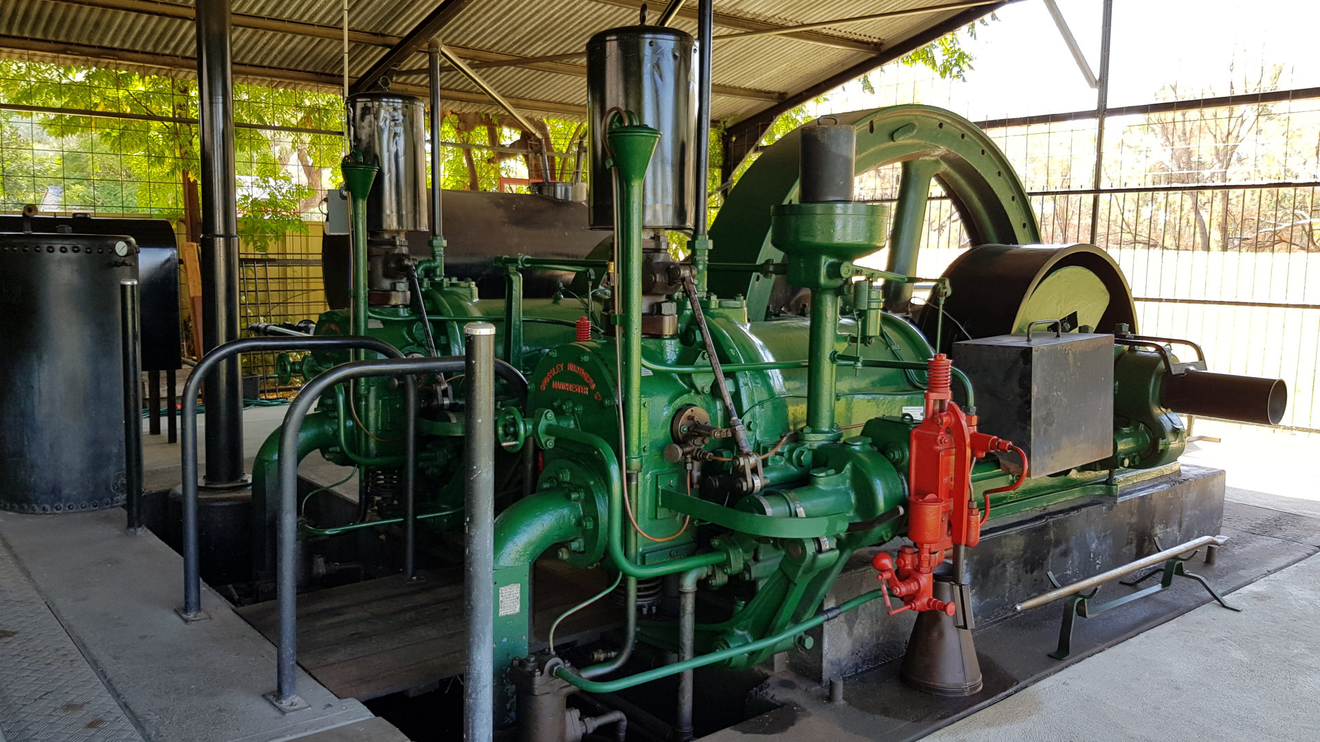 The Crossley Engine in Bourke, an oil fuelled stationary engine manufactured by the Crossley Brothers in 1923. An early four stroke diesel type engine, following the steam era. With two cylinders the 108.6 litre engine produced 103kW of power at 260rpm.