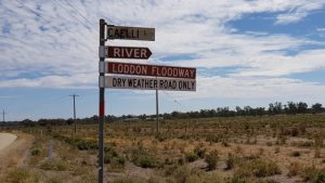 Brown signs for River and Loddon Floodway. Sign for Caelli Ln, and sign for Dry Weather Road Only