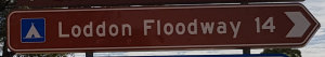 Brown sign for Loddon Floodway, 14km