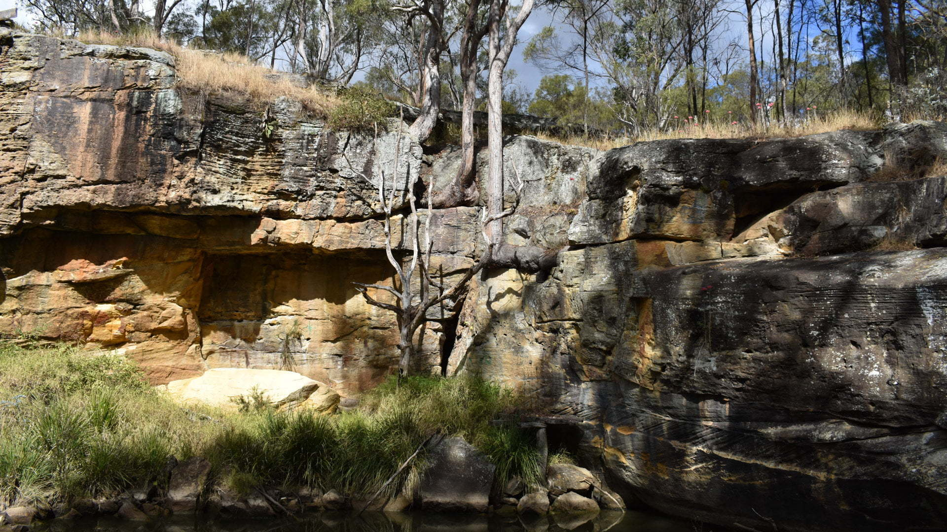Rock walls at the Pump Hole on the trail walk in Crows Nest. The walk starts at Bullocky's Rest Park and follows Applegum Walk along Crows Nest Creek and Bald Hills Creek to Hartmann Park, then through the township of Crows Nest