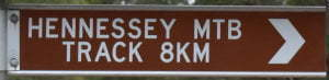 Brown sign for Hennessey Mtb Track, 8km