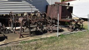Old and rusting farming equipment, located at the Harrisville Historical Museum