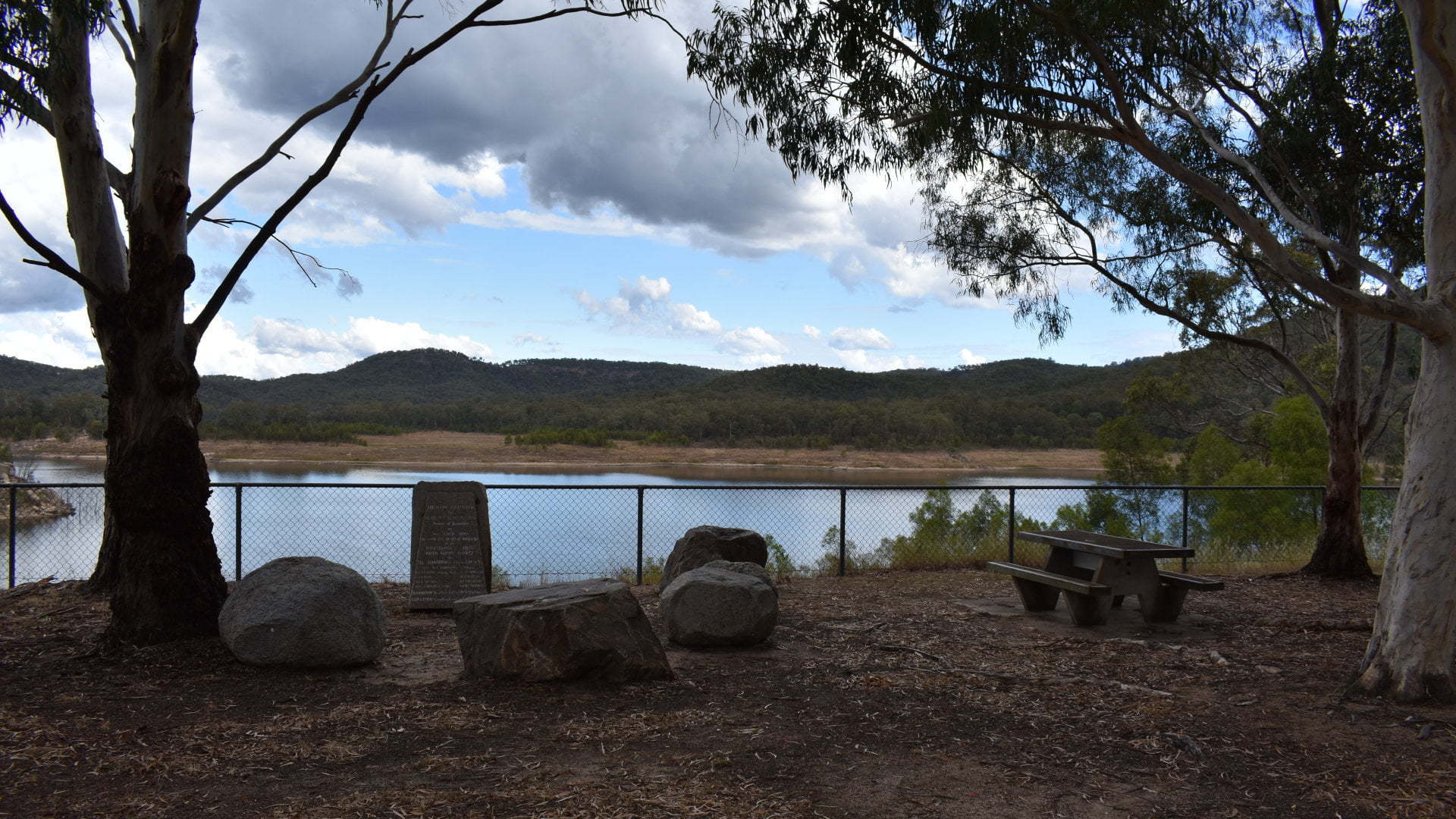 Monument with views of Lake Perseverance behind it, located at the western spillway park. Lake Perseverance is one of three dams that supply most of the water to Toowoomba. A park on either side of the spillway, and a separate park at the pump station with more facilities