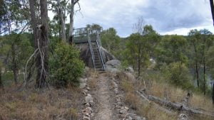 Walkway leading to stairs up a rock, a lookout over Lake Perseverance