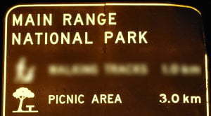 Brown sign for Main Range National Park Picnic Area, 3km, symbol for picnic area