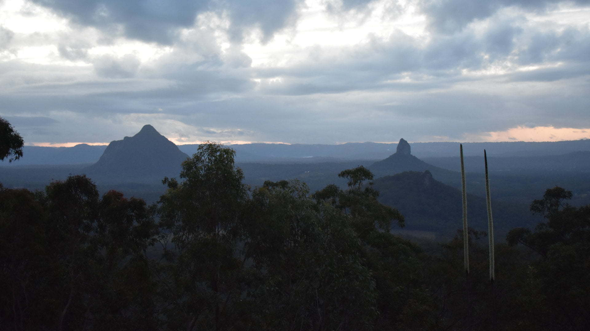 View from the summit of Mt Beerburrum. The lookout has views in all directions of Mt Tibberoowuccum, Mt Coonowrin, Mt Beerwah, Mt Tibrogargan, Wild Horse Mountain, Mt Tunbubudla, Bribie Island and the mountain ranges.