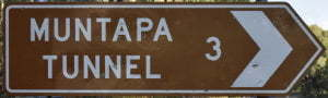 Brown sign for Muntapa Tunnel, 3km
