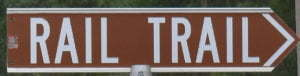 Brown sign for Rail Trail
