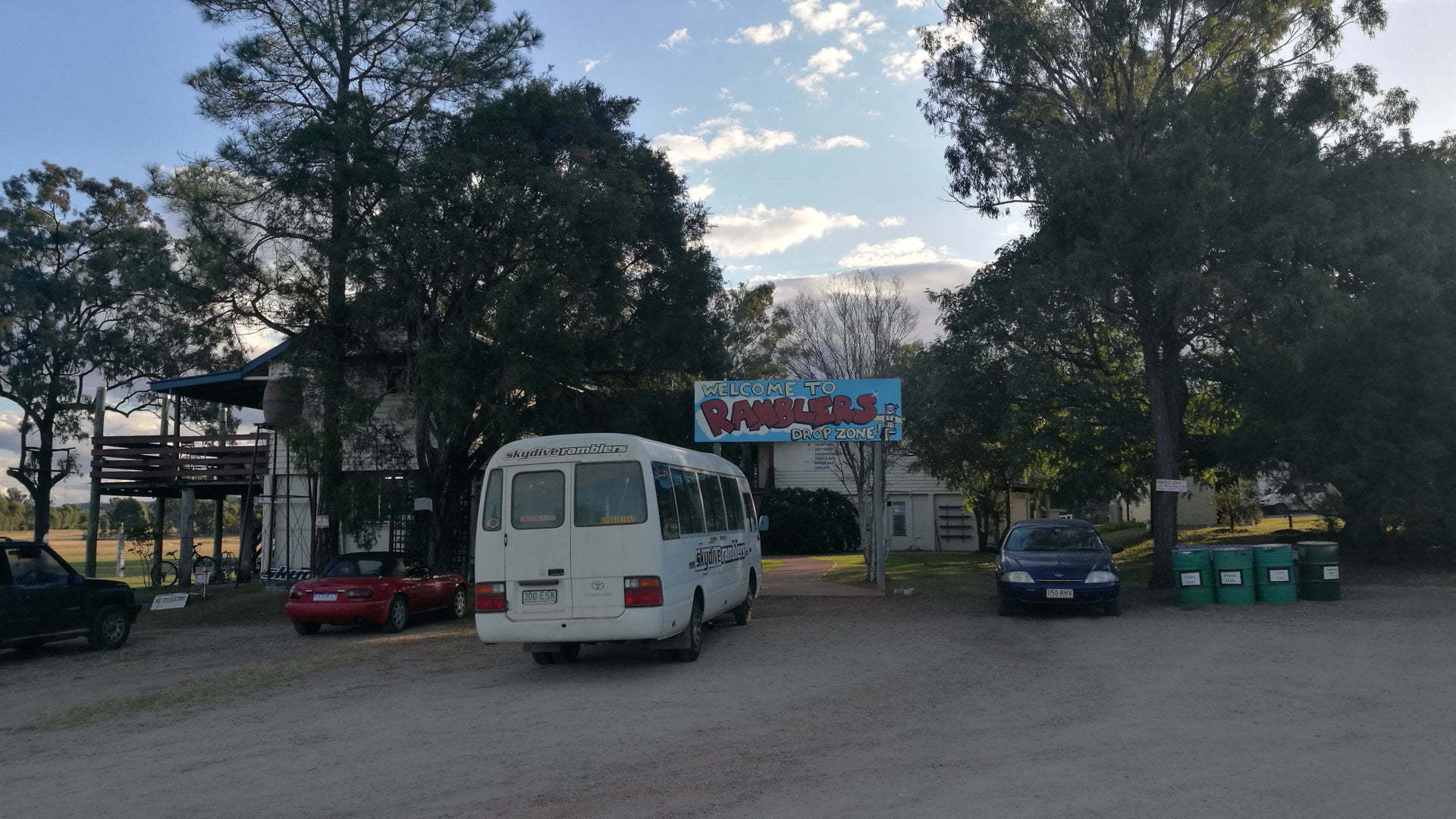 Parking and entrance to Ramblers, a skydiving organisation, offering skydiving, parachuting and tandem skydiving, and onsite accommodation. Ramblers Drop Zone is at Toogoolawah north of Esk