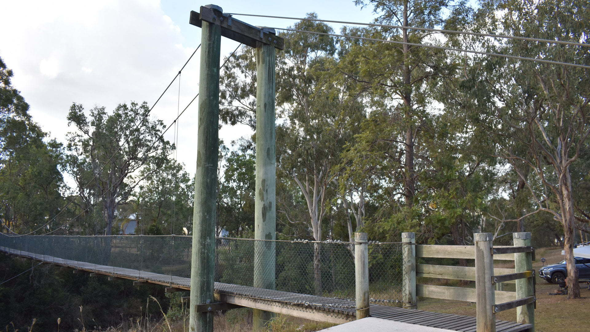 Suspension bridge at the Swinging Bridge Park at Cooyar over the Cooyar Creek. Free camp location with power available by paying at the pub