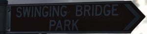 Brown sign for Swinging Bridge Park