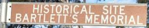 Brown sign for Historical Site Bartlett's Memorial