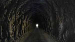Looking through a tunnel with light from the opening in the distance, taken from inside the Boolboonda Tunnel