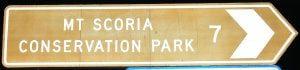 Brown sign for Mt Scoria Conservation Park, 7km