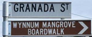 Brown sign for Wynnum Mangrove Boardwalk, sign for Grandada St