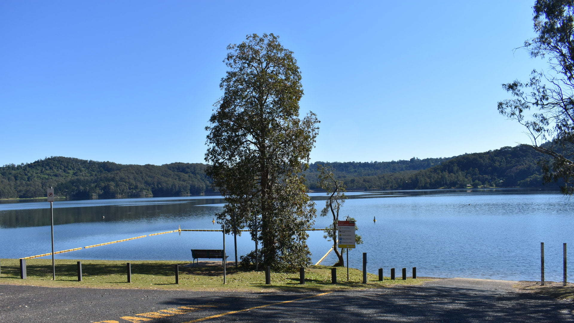View of lake with boat ramp and swimming area, at the Baroon Pocket Dam of Lake Baroon at the North Maleny area