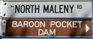 Brown sign for Baroon Pocket Dam, white sign for North Maleny Rd