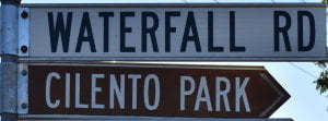Brown sign for Cilento Park, white sign for Waterfall Rd
