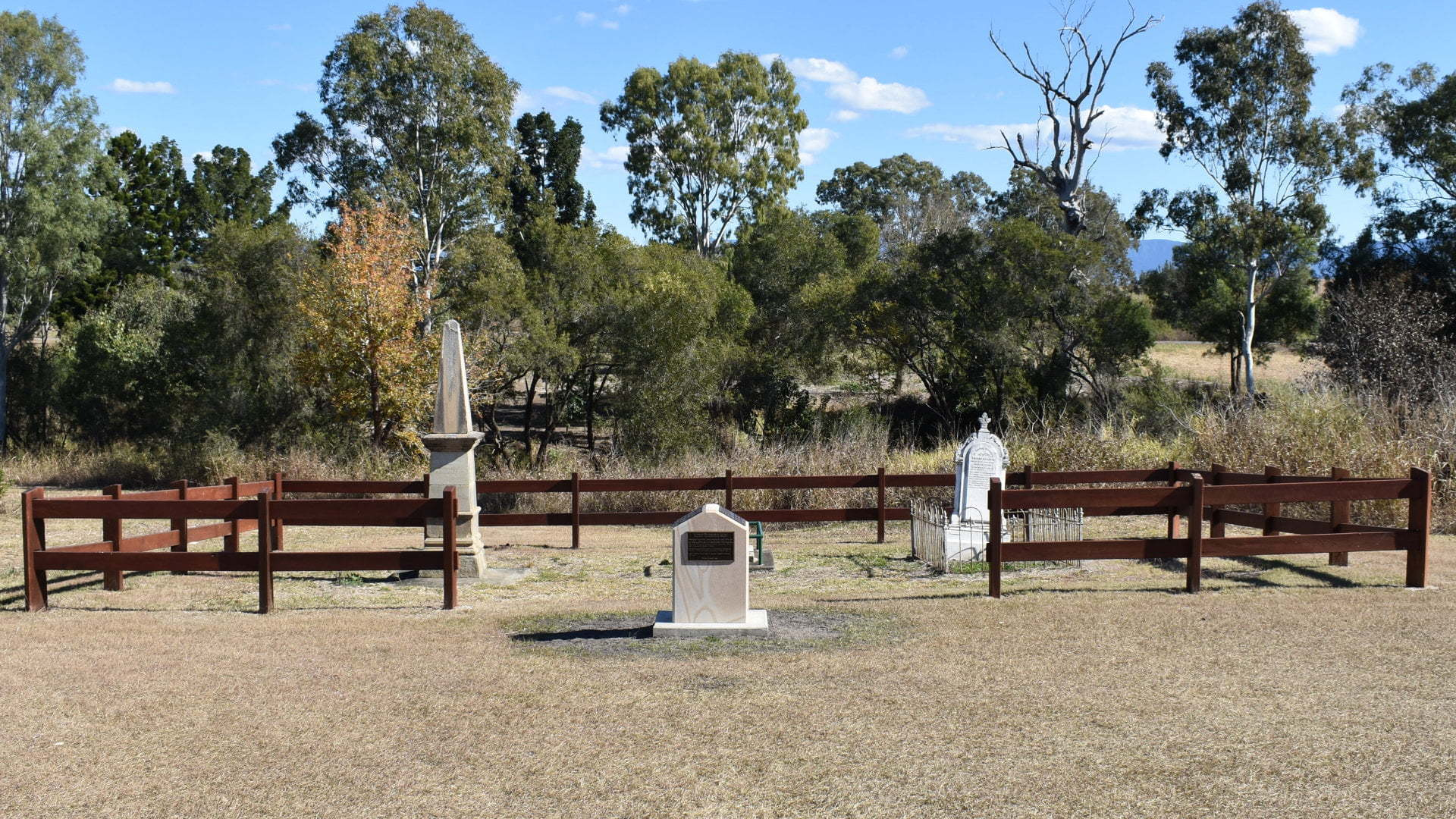 Pioneer Graves fenced in area, memorial in front. Graves of pioneers in the Fassifern area, Alexander Balbi, Sarah Campbell Mercer, and Anders Nielsen