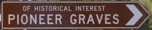 Brown sign for Of Historical Interest Pioneer Graves