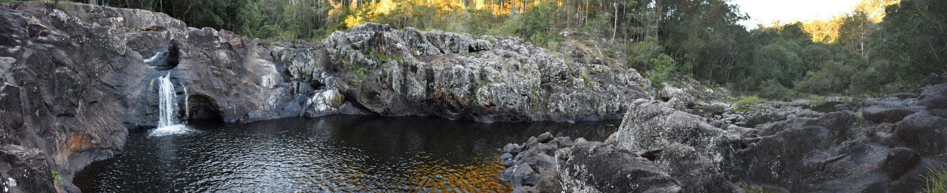 Panorama view of the waterfall and waterhole at Wappa Falls in Yandina