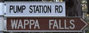 Brown sign for Wappa Falls, white sign for Pump Station Rd