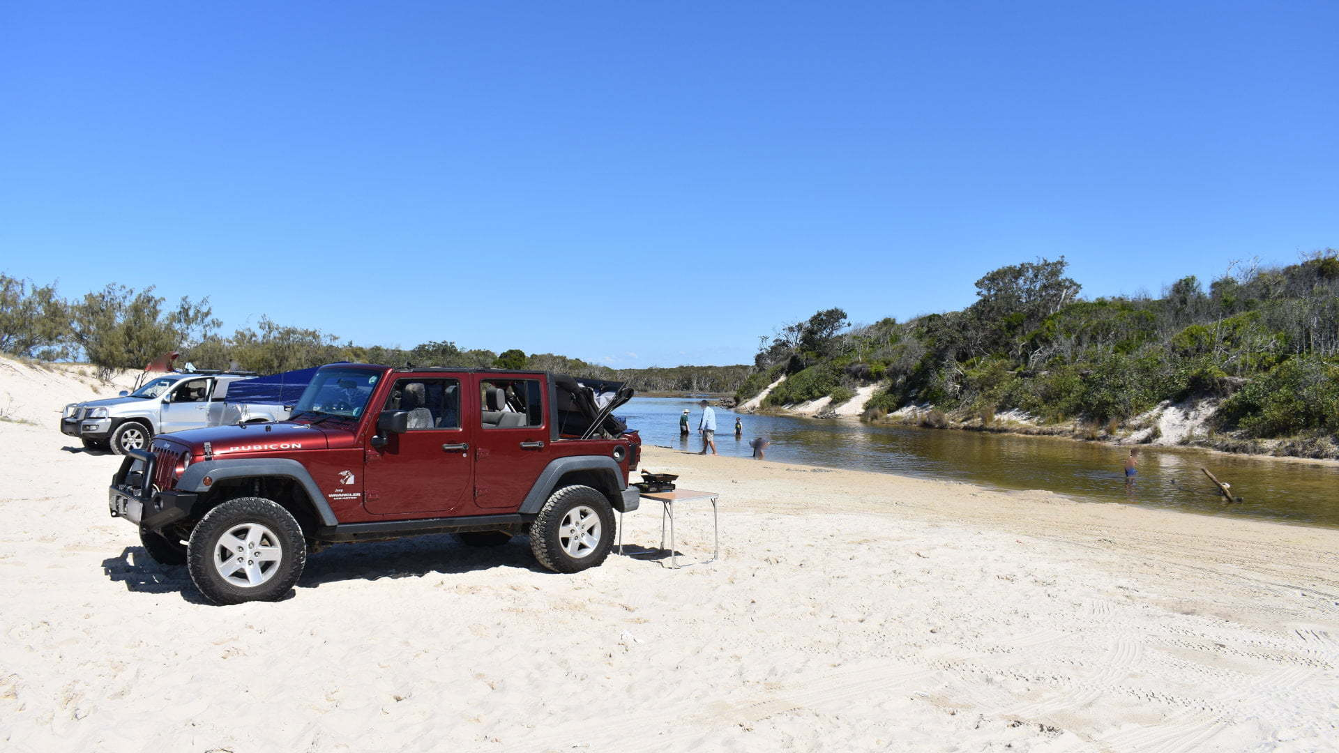 Jeep at the beach, at the Second Lagoon, also known as Norfolk Lagoon, on Ocean Beach Bribie Island
