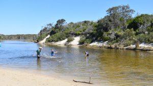 Sandy lagoon water, children playing, at second lagoon or Norfolk Lagoon, at Ocean Beach on Bribie Island