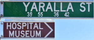 Brown sign for Hospital Museum, green sign for Yaralla St