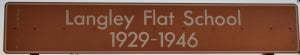 Brown sign for Langley Flat School 1929-1946