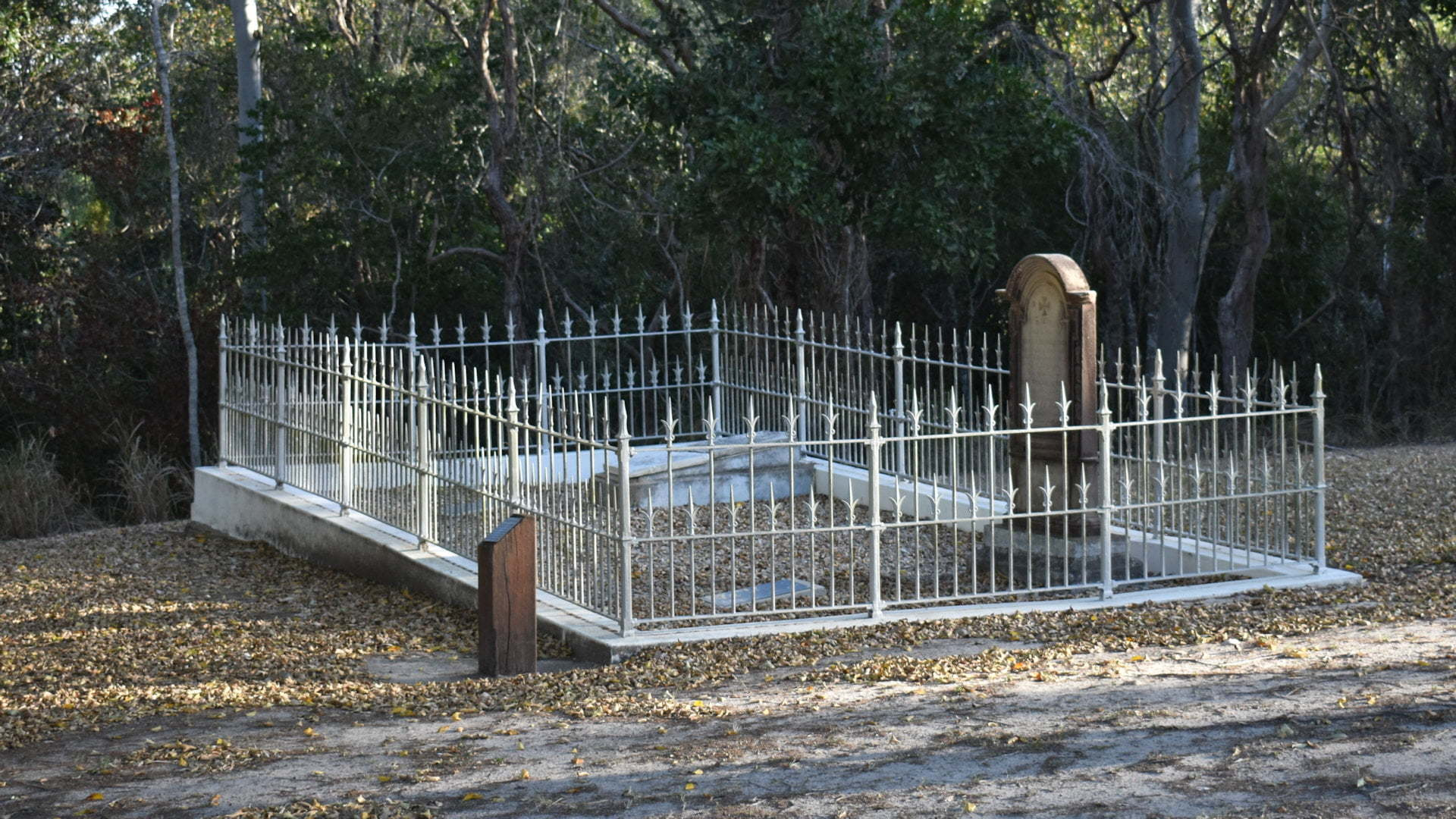 Small grave site surrounded by cast iron fencing, the McAdam graves at the Pioneer Graves of the original Maryborough site