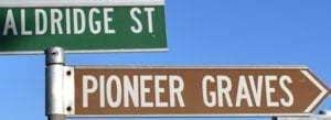 Brown sign for Pioneer Graves, street sign for Aldridge St