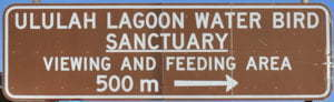Brown sign for Ululah Lagoon Water Bird Sanctuary, viewing and feeding area, 500m