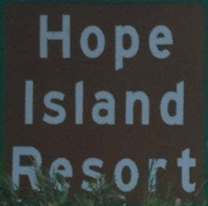 Brown sign for Hope Island Resport