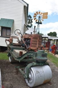 Old roller in a museum, an English built base with an International Harvester Farmall tractor on top