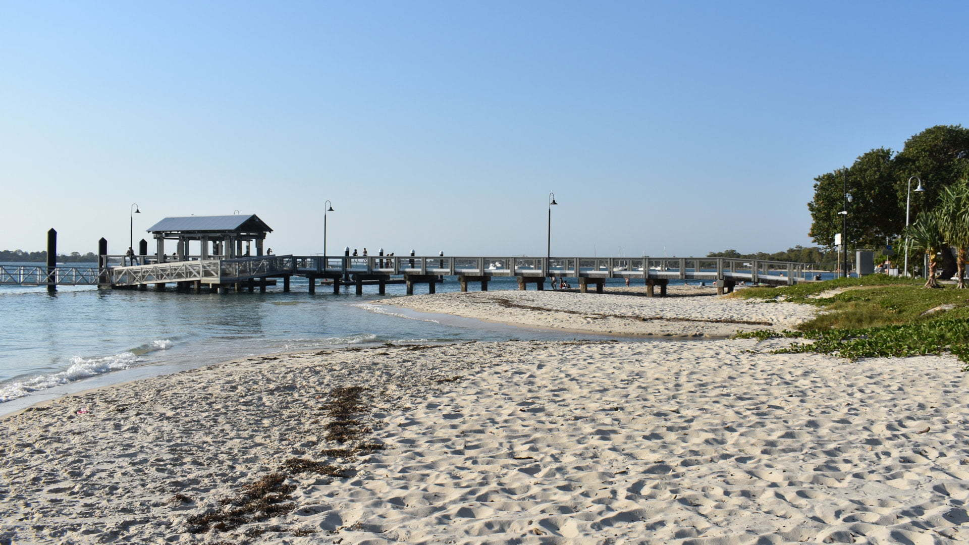 Jetty and sandy beach, at Bongaree Jetty on Bribie Island