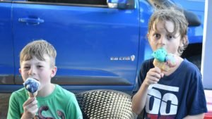 Two boys enjoying ice-cream, from Scoopy's near Bongaree Jetty on Bribie Island