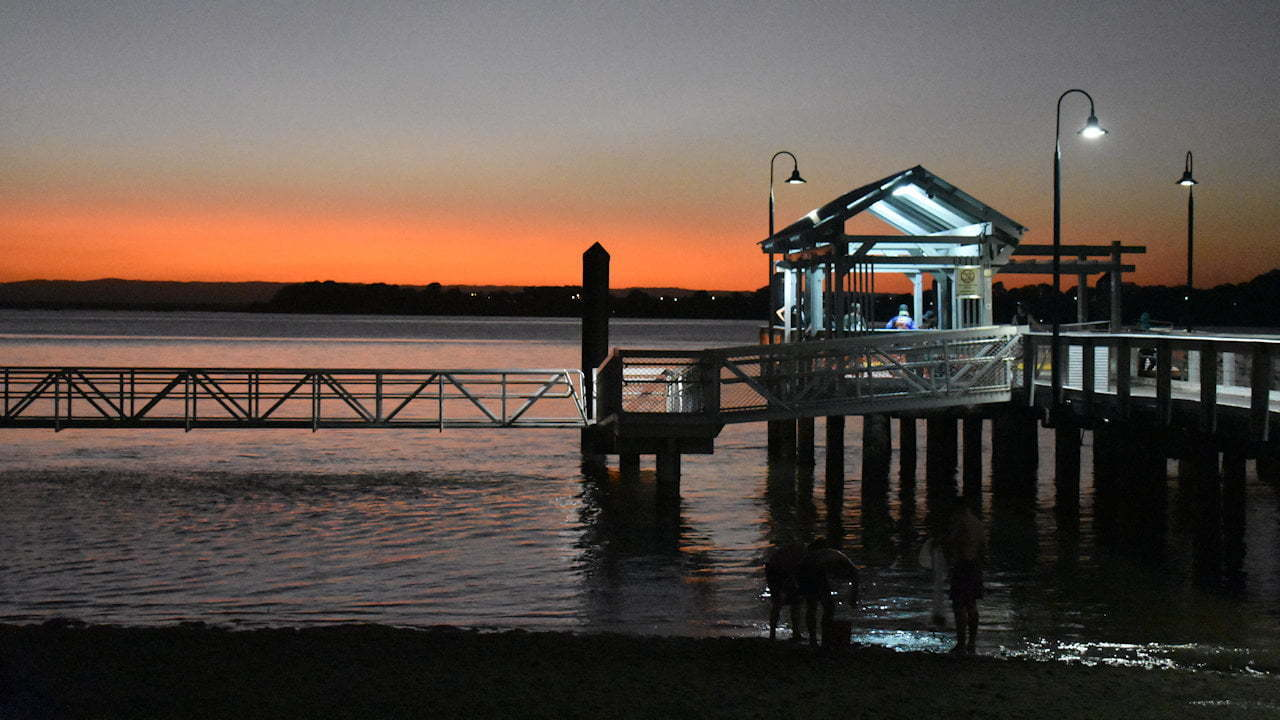 Bongaree Jetty on Bribie Island with the glow of a late sunset over Pumicestone Passage