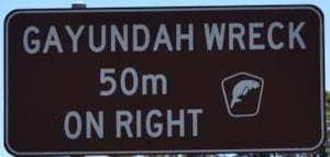Brown sign for Gayundah Wreck, 50m on right