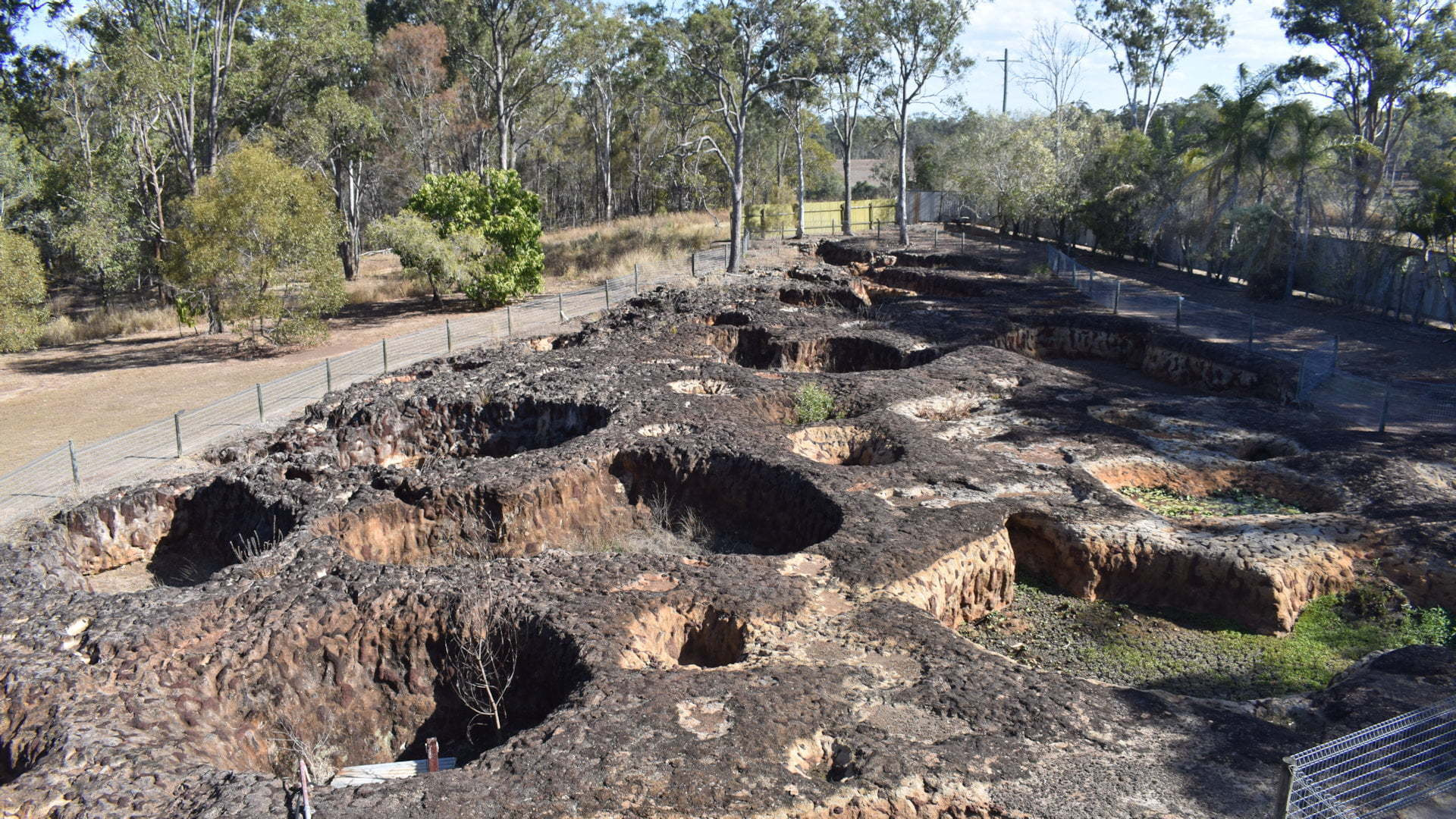 Rock slab with large crater holes, at The Mystery Craters near Bundaberg, a mystery that has baffled scientists across the world since the 1970s