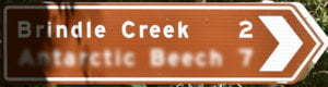 Brown sign for Brindle Creek, 2km