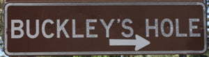 Brown sign for Buckley's Hole