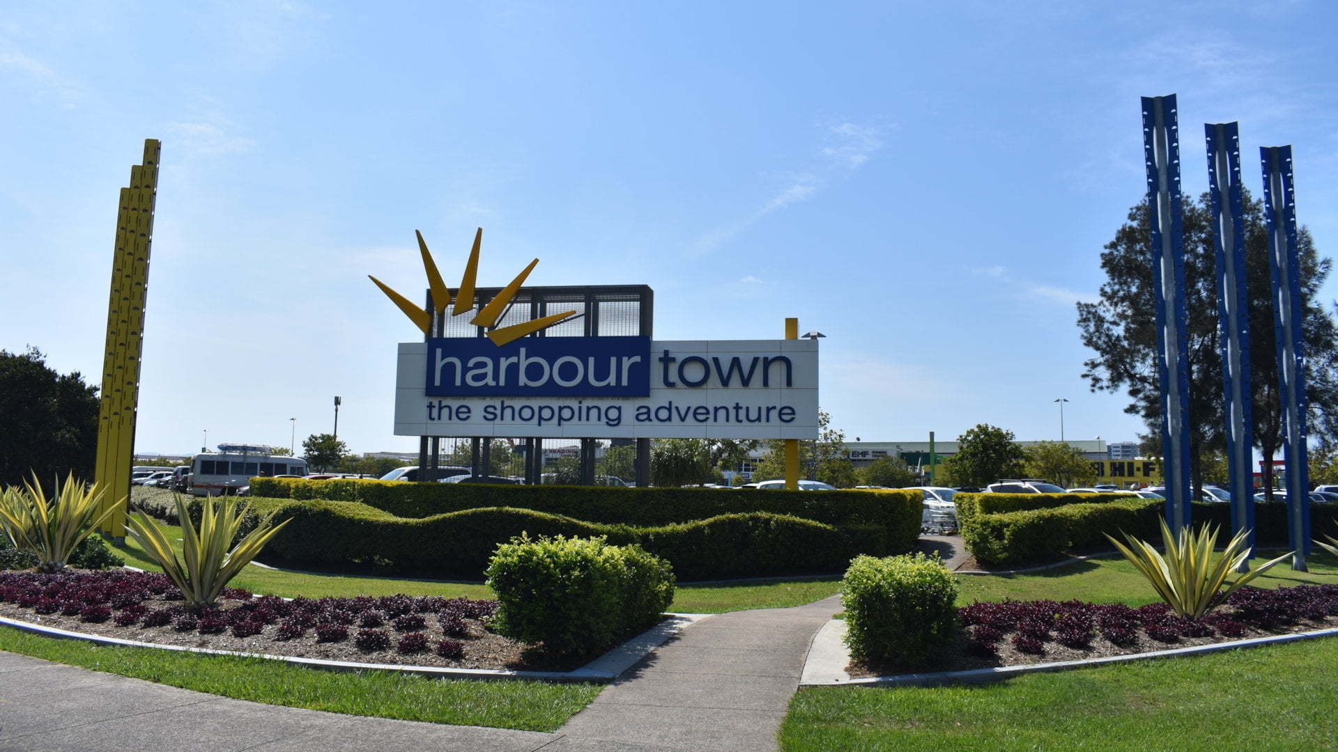 Sign for Harbour Town Shopping Centre, the shopping adventure