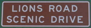Brown sign for Lions Road Scenic Drive